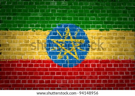 An image of the Ethiopia flag painted on a brick wall in an urban location