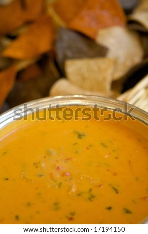 An image of tortilla chips and fresh chili con queso
