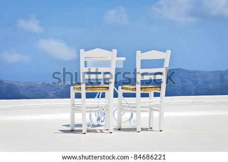 An image of two chairs in the sun