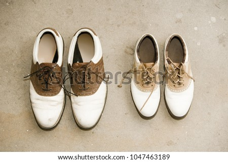 An image of Two pairs of shoes #1047463189