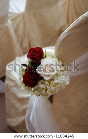 stock photo an image of Wedding flowers in a church at the end of the