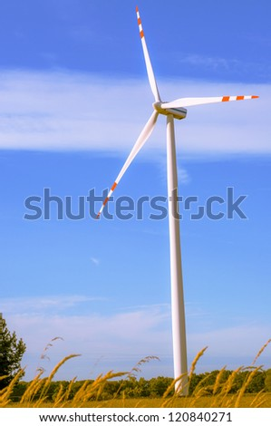 An image of windturbine of suny day