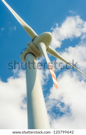 An image of windturbines against blue sky