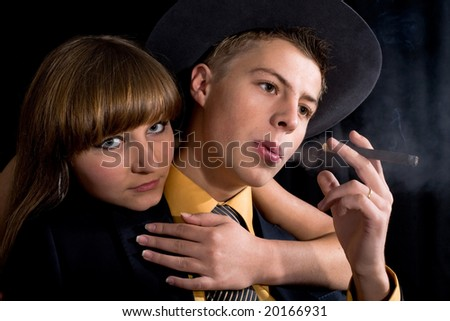 An image of woman and man with cigar in dark room