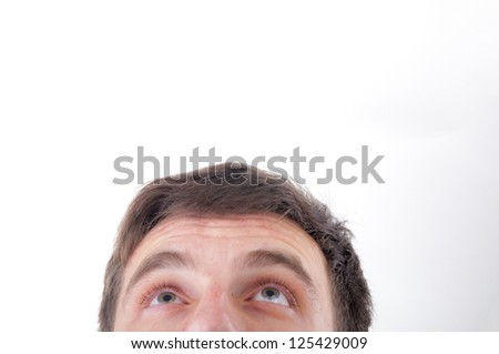 An image of young man staring up