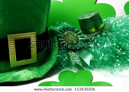 An image showing the concept of St Patricks Day with a green hat and shamrocks