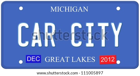 An imitation Michigan license plate with December 2012 stickers and Car City written on it making a great Detroit or Michigan auto concept.  Words on the bottom Great Lakes.