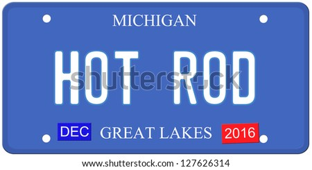 An imitation Michigan license plate with December 2016 stickers and HOT ROD written on it making a great Detroit or Michigan auto concept.  Words on the bottom Great Lakes. - stock photo