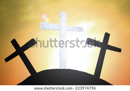 An impression of the three crosses on the mountain golgotha representing the day of christs crucifixion in a sunset.