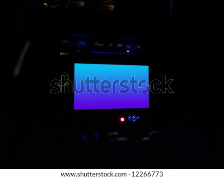 An in dash lcd screen commonly used for a navigation system or other in car entertainment.  This file includes a clipping path for the screen area.