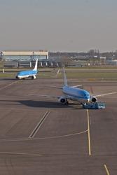 An incoming aircraft and a departing aircraft