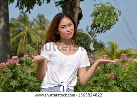 An Indecisive Diverse Asian  Person