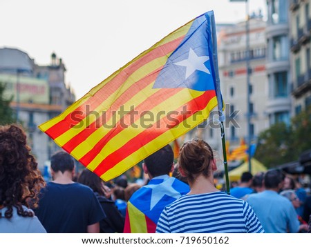 An independence flag being carried by a young woman in Barcelona. September 20th 2017, a key date in Catalonia's history #719650162