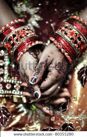 An Indian bride and the henna artwork on her hands