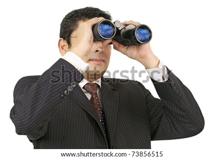 An Indian businessman in his late thirties looking through binoculars.