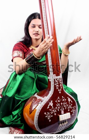 An Indian classical singer with the string instrument called Tanpura.