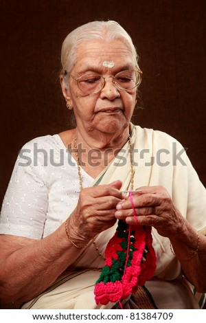 An Indian grandmother crocheting