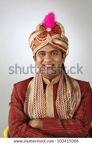 An Indian groom wearing the traditional sherwani attire.