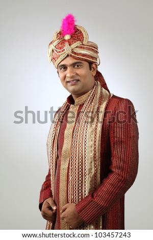 An Indian groom wearing the traditional sherwani attire.