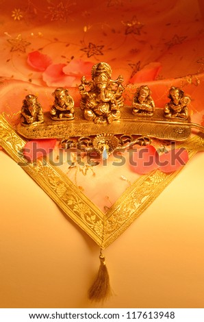 An Indian lamp with Ganesha Idol.