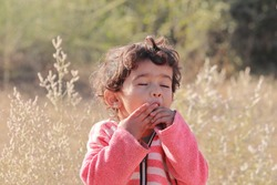An Indian little child enjoying fruits in the forest, india