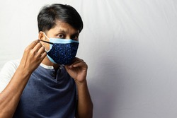 An Indian man shows double masking during covid-19 pandemic, healthcare concept