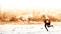 An Indian or asian tribal girl running on the ground and she is wearing a shawl. People running because they are seen a zombie on the road. Defocused or blurred image.