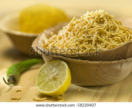 An indian snack 'sev' in a natural bowl.