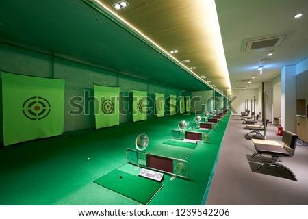 an indoor golf driving range