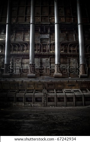 An industrial scene at an abandoned factory, old pipes rising like an organ.