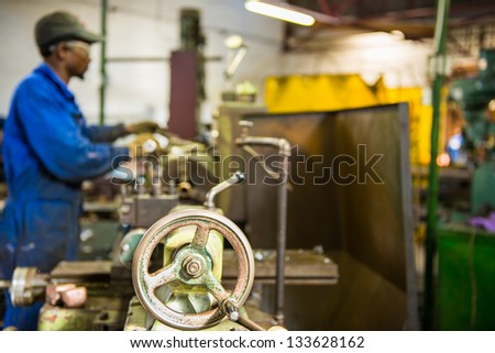 An industrial service repairmen labouring in workshop