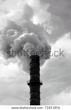 an industrial smoke stack belches out noxis smoke and crud including dreaded CO2 and other global warming gasses freely into the automosphere quickly ruining our earth and enviroment for all