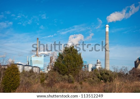 An Industrial Smoke Stack Releases Pollution into the Air