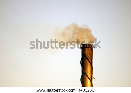 An industrial smokestack emitting polutants into the atmosphere.