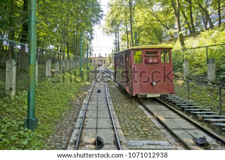 An industrial vintage funicular on a steep slope. Railway in a green park