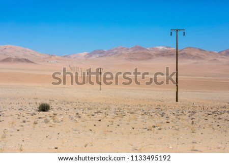 An infinite electrical line going to an endless horizon carrying with it the energy to feed the small populations inside the Atacama Desert, one of the most remotes places on Earth