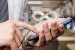 An infinity sign appears from the phone on a blurred background.