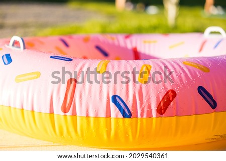 An inflatable donut swimming r on the house lawn Stock fotó ©