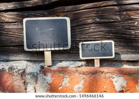 An information sign stands on a brick and wooden obsolete wall #1496466146
