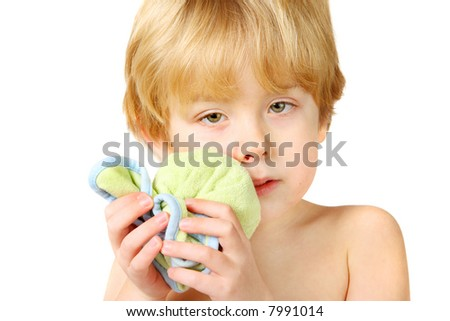 An injured boy holding an ice pack on his lip and cheek