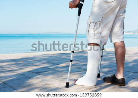 An Injured man with a plaster on the beach