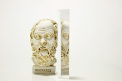 An installation consisting of Socrates statue and prism on white background.