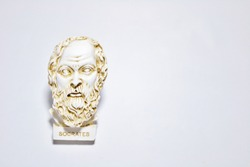 An installation consisting of Socrates statue on white background.