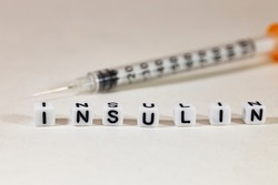 An insulin syringe for the treatment of diabetes on a white background and the inscription
