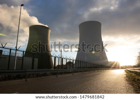 an intact nuclear power plant at sunset