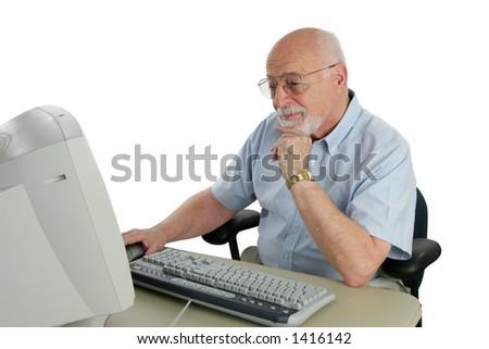 An intelligent senior man doing research on-line.
