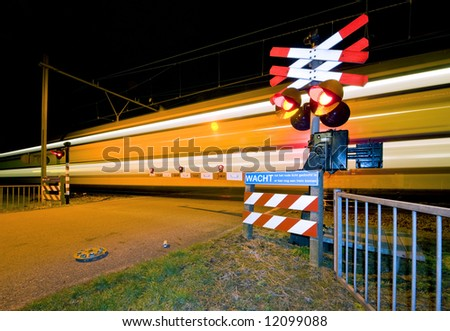 An intercity passing a railroad crossing at night