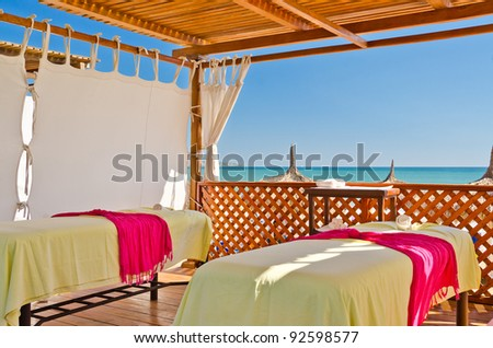 an interior of spa gazebo with nice ocean view in background