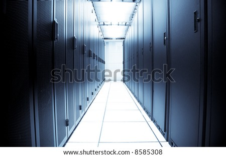 An interior shot of a computer data center (in blue tone)