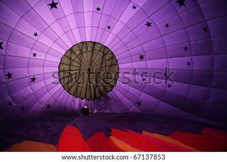 An interior view of a purple hot air balloon inflating
